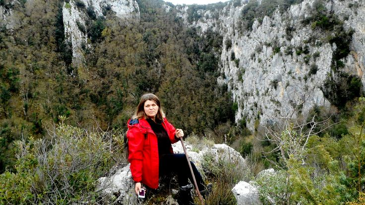 Our friend Onorica sitting almost on the brink of the #Revotano, a 80m deep and 250m wide karstic chasm, beautiful, thrilling and rich in legends and popular immagination