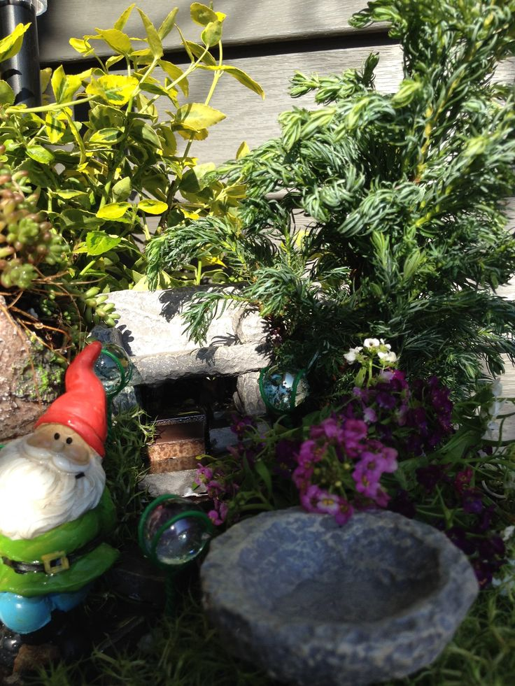 Gnome of Ensley Hill -- bench and birdbath detail