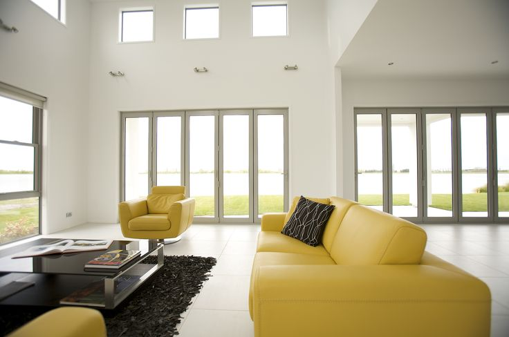An extra high ceiling adds a grandiose feel to the living room which offers a spectacular view.