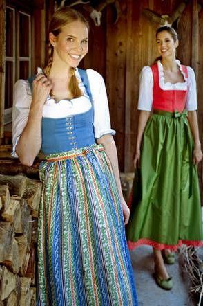 Tostmann Dirndl im Salzburger Blau mit Seiden-Jacquard Schürze, rotes Dirndl mit grüner Seidenschürze