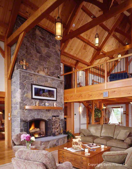 This vermont ski home features an open concept floor plan for Lodge style fireplace ideas