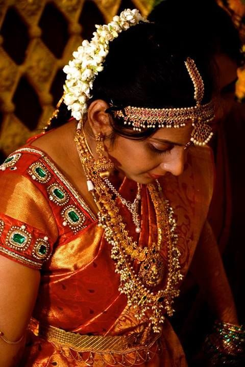 traditional south indian bride wearing bridal saree, jewellery and makeup