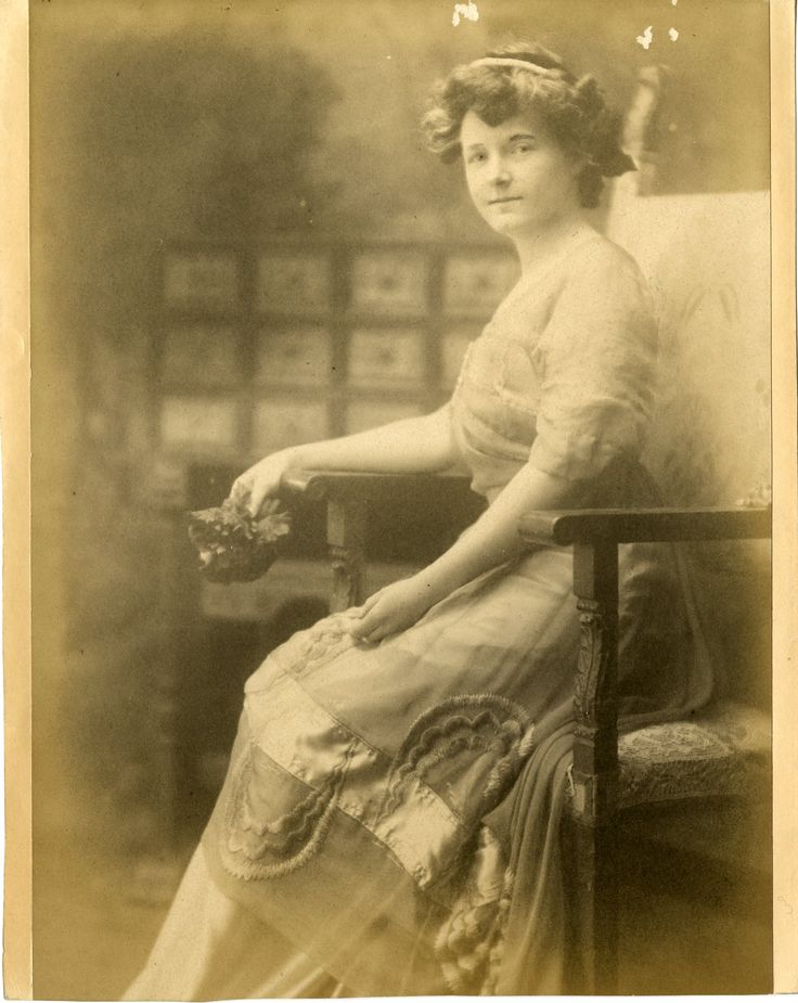 Hortense Mitchell Acton in Paris in 1909 wearing a Callot Soeurs dress.   I think she loves her dress.