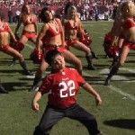 Kid dances with Tampa Bay Buccaneers Cheerleaders