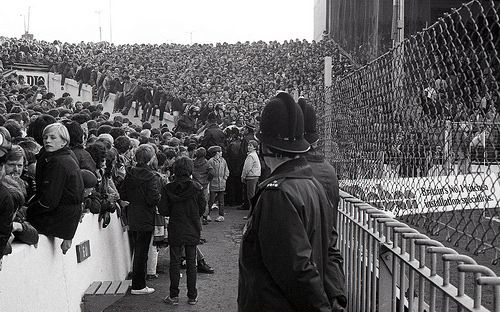 An image from the policing of the Manchester Derby of 1981. The games that year both took place at Manchester City's Maine Road. The year marked the 100th anniversary of the first time the two sides met. The first game took place on 12th November 1881 when West Gorton (St Mark's) - who later became Manchester City, took on Newton Heath LYR – the forerunners of Manchester United. The fixture is always a major talking point among Manchester football fans and draws major crowds…