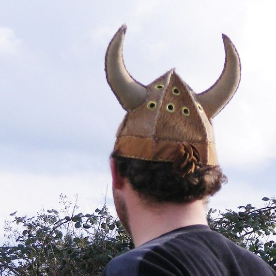 t is not known if vikings really wore horned helmets,but i love the idea.  *I made several of these mythical helmets for the Scandinavian Festival in my home town of Junction City, Or.  *Most of them were sold at that event.   $150 *The helmet is made of hair on cowhide and a softer leather  band and shock of fringe in the back.