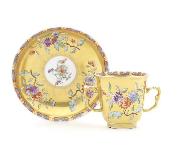 A Meissen gold ground cup and stand