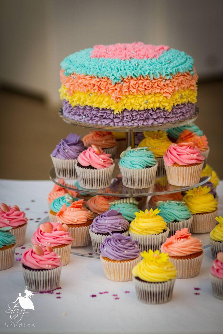 Beautiful wedding cake and cupcakes!