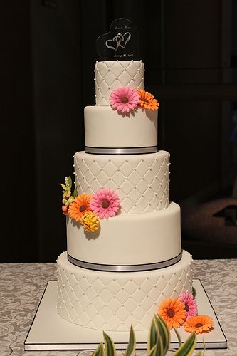 Quilted Wedding cake with Gerbera Daisies. (Change the flowers and ribbon color.)