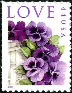 The Pansies in a Basket commemorative love stamp features a detail from a watercolor created by Dorothy Maienschein. The design was used on a Mother's Day card from 1939, and since 1942 nearly 30 million cards with this design have been purchased- more than any card in history.