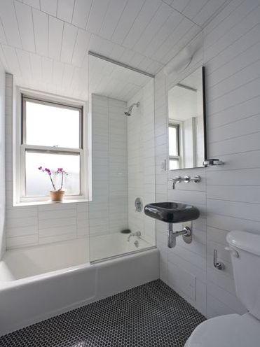 white bathroom black and white penny tile floor