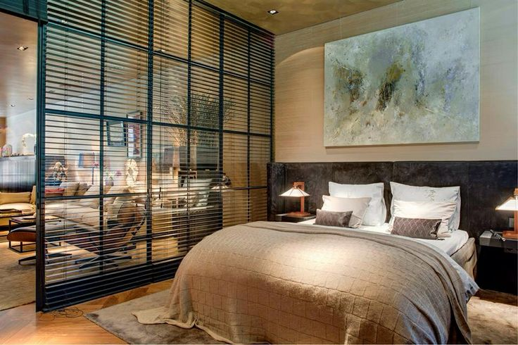 Loft idea. Love the windows that seperate bedroom from rest of loft. Keeps light flowing & you can create privacy with blinds or curtains.