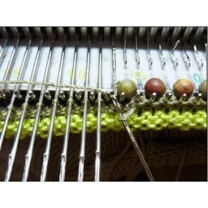 Knitting in beads on machine