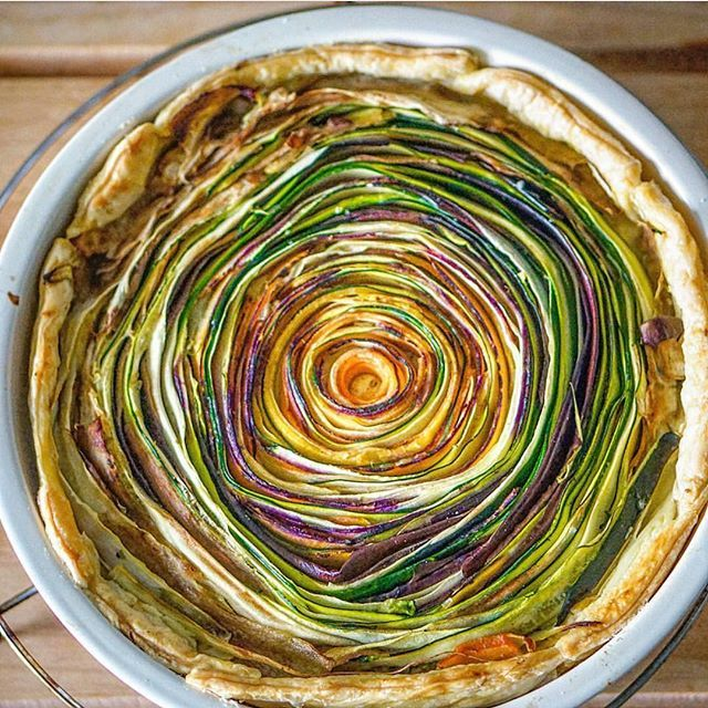 This vegetable tart uses seasonal vegetables to create a beautiful spiral pattern. The vegetarian dish is much easier than it appears, and is sure to be a hit at your next dinner party. The crème f…