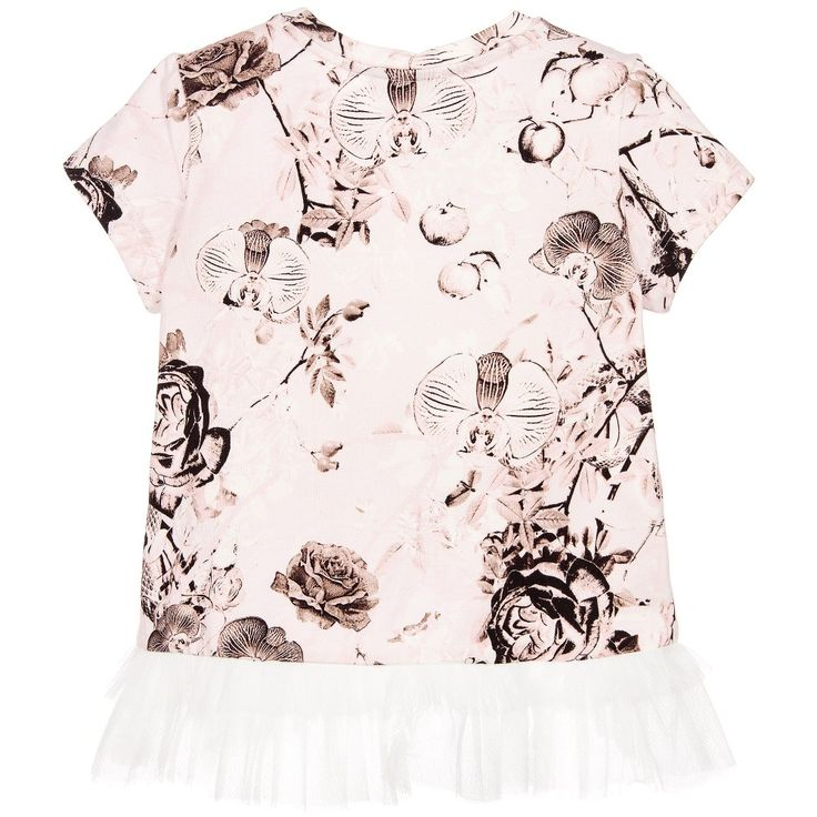 Girls beautiful, pink top by Roberto Cavalli with a gorgeous rose, orchid and snake print. Made in soft cotton jersey, it has white tulle pleats across the shoulders and frills on the hemline, which is slightly longer at the back than the front. It has the designer's silver metal logo motif sewn on the front.