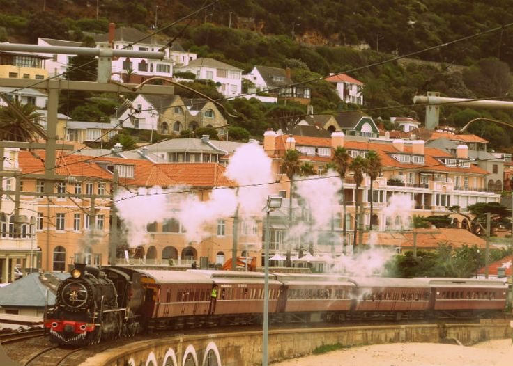 The Vintage Steam Train coming past Kalk Bay. Walking Cape Town – The Easy Fish Hoek To Muizenberg Route