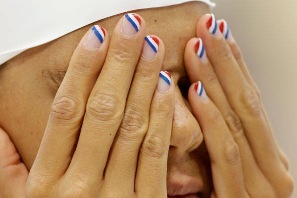 French swimmer Coralie Balmy makes waves in the pool — but there's nothing too splashy about those understated nails bearing le drapeau tricolore.