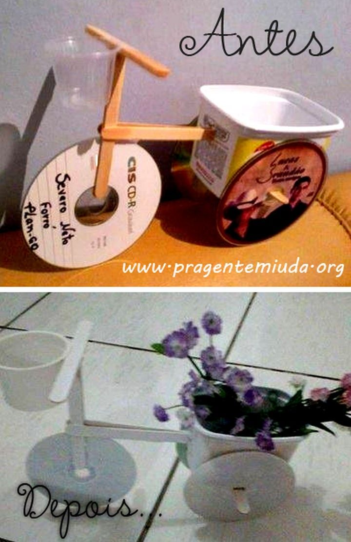 Build a tricycle flower pot using old CDs and Popsicle sticks