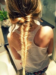 Blonde fishtail braids are a go to summer style.