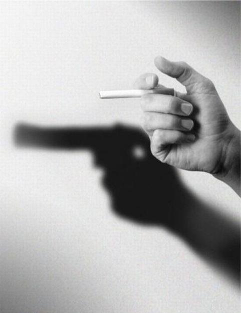 This metaphor of smoking shows the negative effects of smoking. The shadow of the gun stands for killing due to second hand smokers.