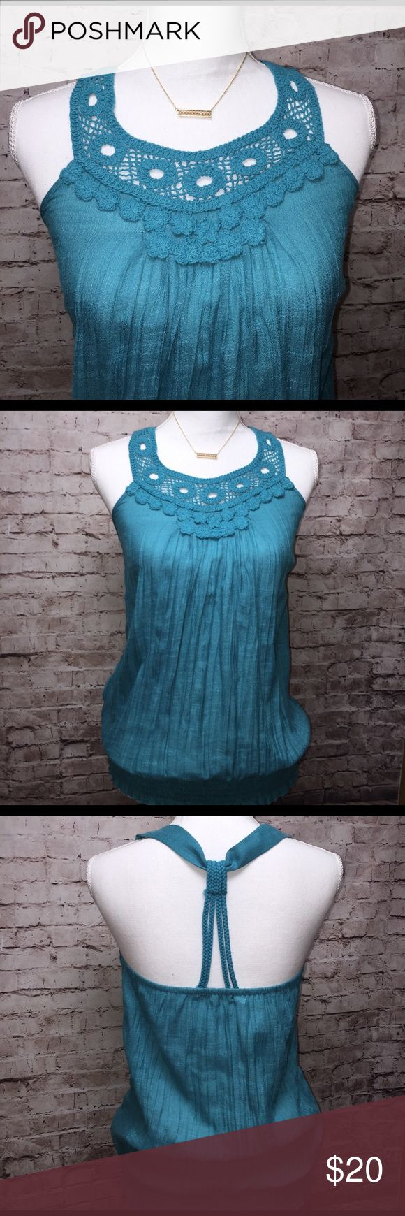 Mother's Day Sale 🌺 FREE SHIPPING 🌺 Turquoise Top by Maurices ... Spring hasn't Sprung but, it's coming soon! Embroidered neckline and rope knot down the spine. Beautiful top for the weekend outing! Size small. NWT Maurices Tops Tank Tops