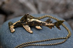 Dee Dee has me looking at shark jewelry, and this one matches my tattoo! Want.