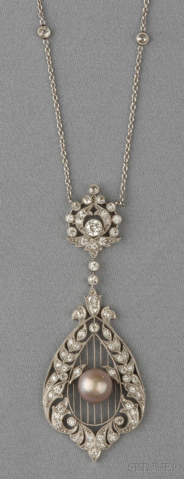 Edwardian Platinum, Natural Pearl, and Diamond Pendant, the pearl measuring approx. 7.50 mm, on knife-edge bars, the frame set with old single and old European-cut diamonds, lg. 2 1/2, suspended from trace-link chain with bezel-set old mine-cut diamonds, lg. 16 1/4 in.