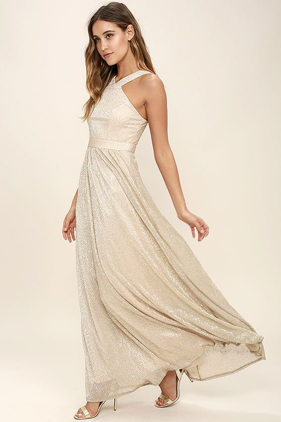 Be the one to close down the party in the Always Moving Gold Maxi Dress! Lightweight, gold flecked Georgette falls from a modified halter neckline (with wide straps), into a princess seamed bodice and an elasticized back. Sweeping skirt cascades from the banded waist. Hidden back zipper/clasp.