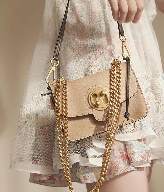 Glamorous glint – the Mily bag in biscotti beige exudes cool femininity with its refined details and striking metal hardware  Find your Mily on chloe.com