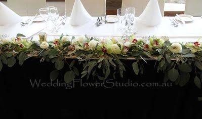 rustic style long bridal table flower arrangement
