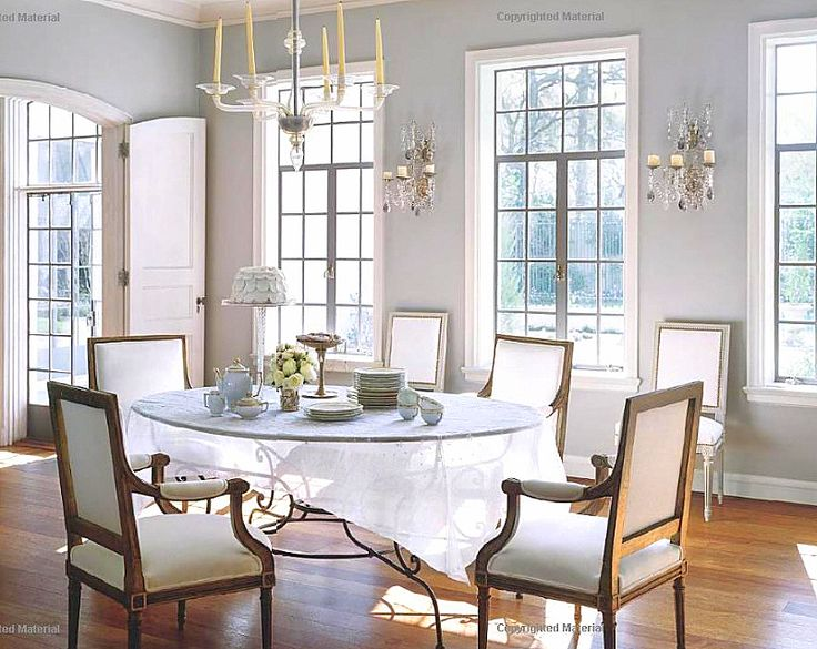 babs watkins used a set of dark stained arm chairs with more white fabric against the wall are additional chairs from the other room - Dining Room Table With Bench Against Wall