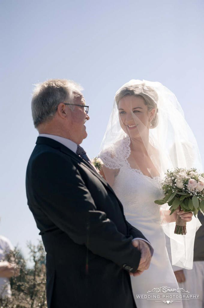 Father of the bride proudly walks with her to the church. Check out other wedding photography by Anthony Turnham at www.snapweddingphotography.co.nz