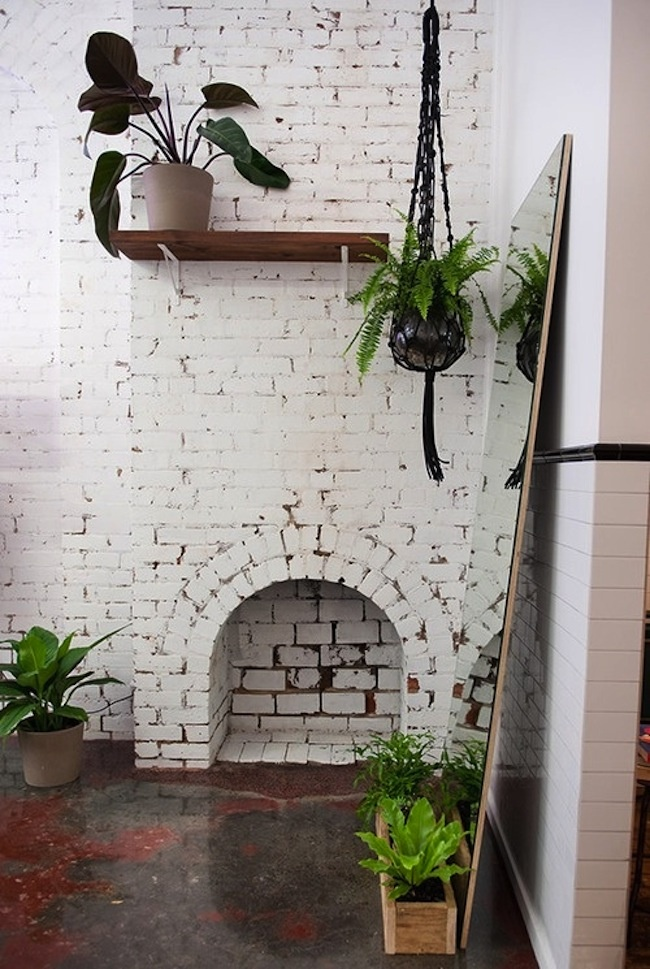 painted brick with acid stained concrete floors...love it!!