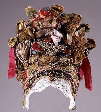 Finnish grannlåtskrona. In Sweden and Finland this type of crown where worn by brides in the countryside and made from whatever embellishements they could find: jewellery, foil, metal pieces, paper, beads, wrapping paper, silk bows and more.