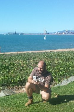 Playing Pokemon Go down along The Strand, Townsville
