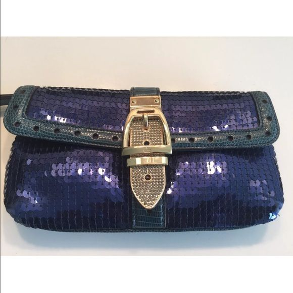 Gucci Evening Bag This royal blue GUCCI sequin evening bag is the only accessory you'll need when styling your next look for a night out on the town. Whether its a denim, cocktail dress or evening gown look, this piece will always be a showstopper. This gorgeous bag, along with my other items are from my personal collection that I have purchased over the years. This Gucci bag was purchased some years ago at the Gucci boutique in Chicago. It's in very good condition. Gucci Bags Clutches…