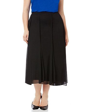 Discover perfectly versatile pieces from our AnyWear Collection that mix, match and pack beautifully, wherever life takes you. Layers of airy mesh fabric give this full skirt an ethereal effect. Vertical seaming creates a slimming paneled design and the flat front waistband smooths and defined your waist. Pull-on design. Fully lined.  catherines.com