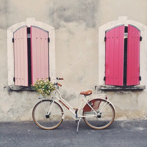 We love that this gorgeous pink bike matches the pink windows!