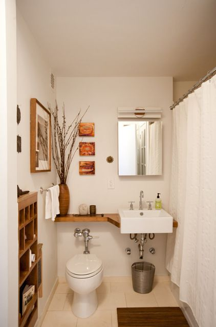 Extend the counter to go over the toilet to get extra counter space in a small bathroom