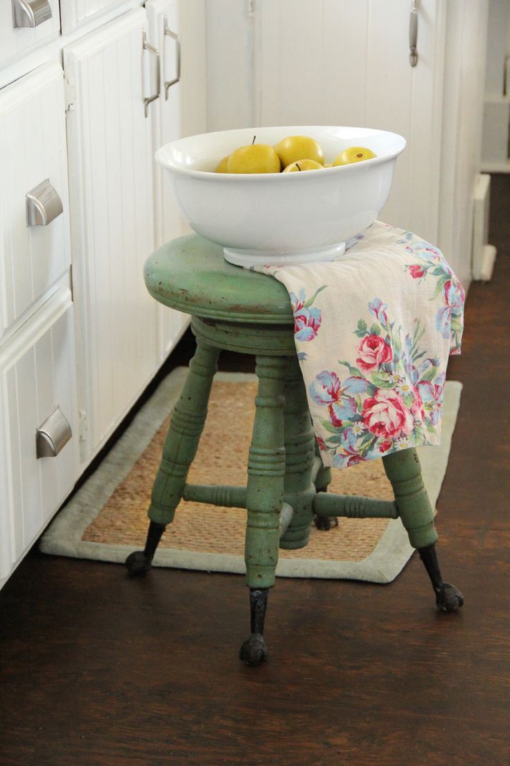 love this little green stool  -  This is not just a stool but actually a piano stool.  The top spins to raise or lower as needed for different pianists.  I have my Grandmother's.  :-D