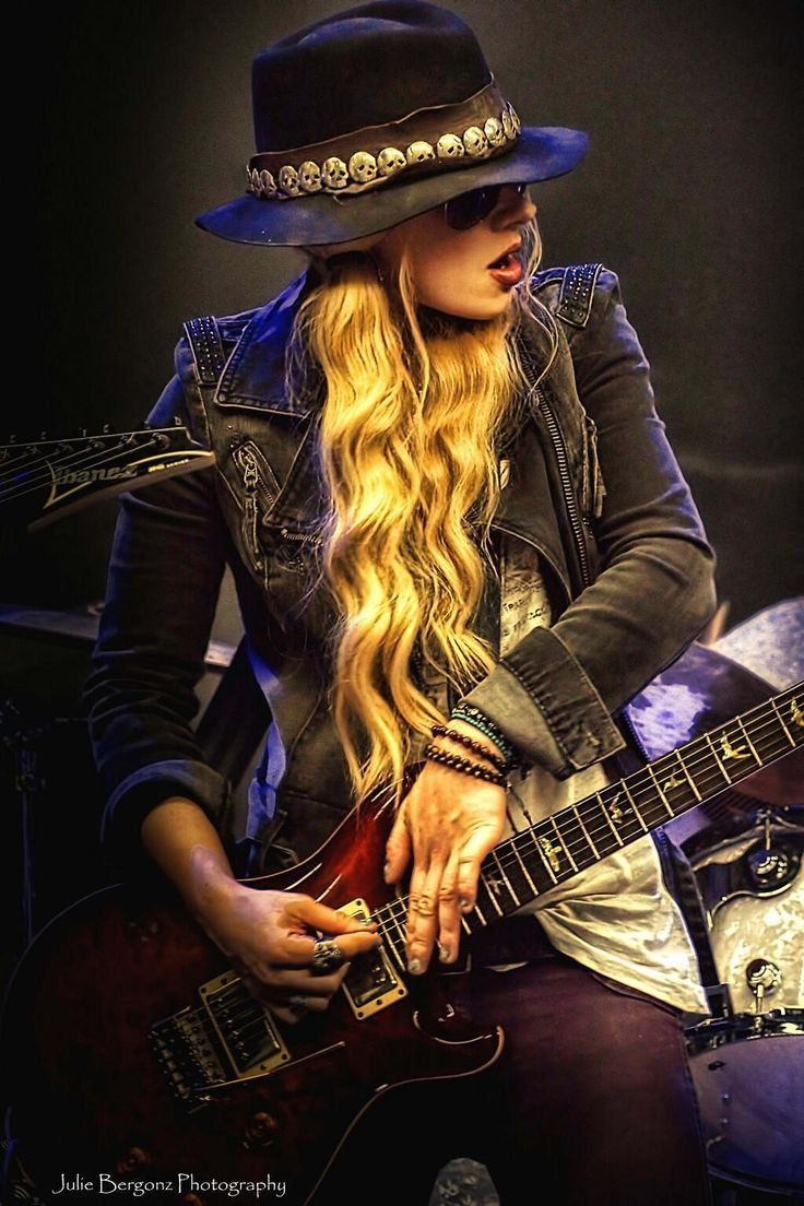 "Orianthi Panagaris (born 22 January 1985), known mononymously as Orianthi, is an Australian singer-songwriter and guitarist. She is perhaps best known for being Michael Jackson's lead guitarist for his ill-fated This Is It concert series, and as the former lead guitarist in Alice Cooper's live band. Orianthi was named one of the 12 Greatest Female Electric Guitarists by Elle magazine.She also won the award as ""Breakthrough Guitarist of the Year"" 2010 by Guitar International magazine."