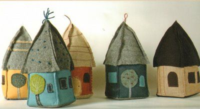 Little houses - filled with sand, used as door stops. To buy but I'm inspired to make my own from felted sweaters.