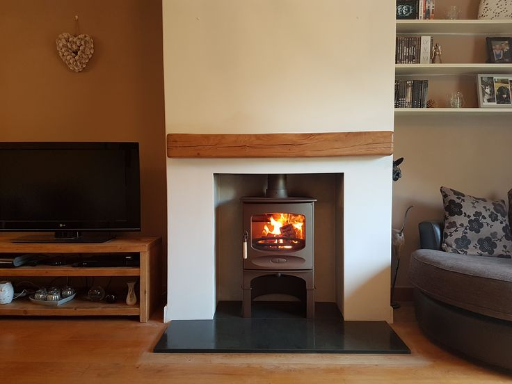 Charnwood C-Five in bronze on store stand with a new slate hearth and traditional beam.
