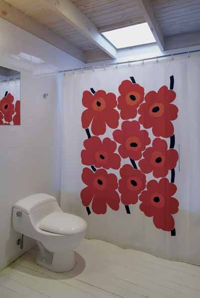 great use of shower curtain in bathroom