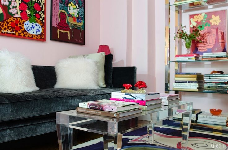 Cotton candy pink paint color, charcoal gray velvet sofa, lucite