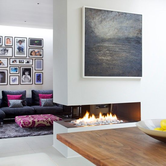 This Ultra Modern Fireplace Has Been Sliced Out Of A Dividing Wall To Create A Super