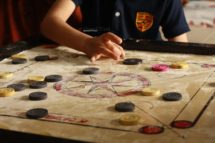 Was playing with my camera and saw the kids playing carrom so i decided to take photos of them while playing loved this shoot and though of sharing it with you Enjoy