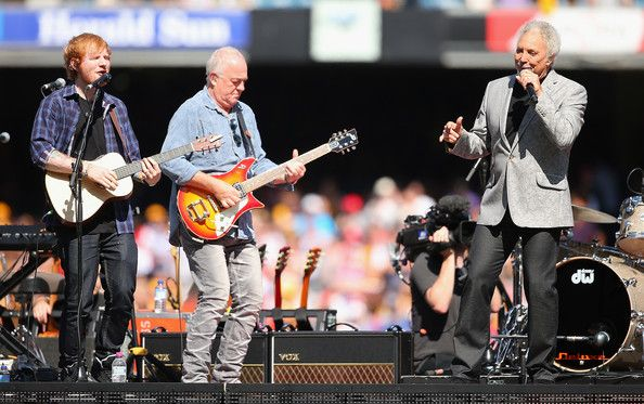Tom Jones Photos Photos - Ed Sheeran and Tom Jones perform during the 2014 AFL Grand Final match between the Sydney Swans and the Hawthorn Hawks at Melbourne Cricket Ground on September 27, 2014 in Melbourne, Australia. - 2014 AFL Grand Final - Sydney v Hawthorn