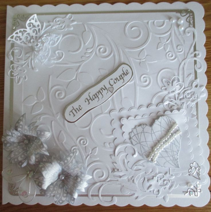 Mainly white Wedding card.