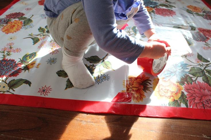 duck tape trim for an oilcloth splat mat!!